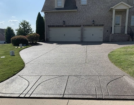 pressure washed driveway in front of a home in nashville